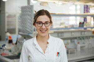 Portrait of smiling laboratory technician in lab - ZEDF00587