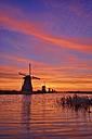 Netherlands, Rotterdam, Windmills at Kinderdijk at sunrise - RUEF01787