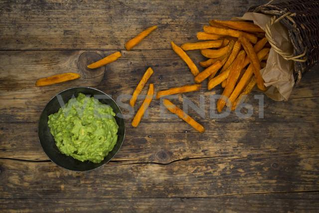 Sweet potato fries and avocado dip on wood - LVF06022