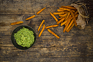 Sweet potato fries and avocado dip on wood - LVF06022
