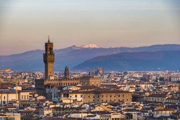 Italy, Florence, cityscape with Palazzo Vecchio at sunrise - LOMF00561