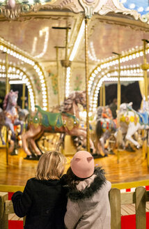 Two girls looking at a Christmas carousel - MGOF03212