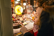 Two girls looking at a Christmas shop window - MGOF03215