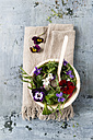 Bowl of leaf salad with red radishes, cress and edible flowers - MYF01907