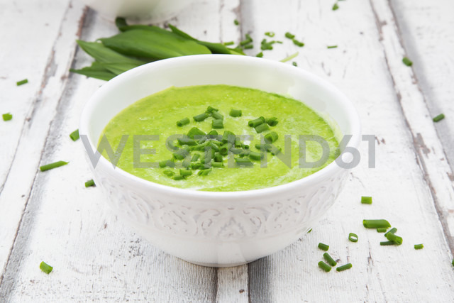 Bowl of ramson soup garnished with chives and cream - LVF06046