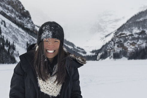 Canada, Banff, Lake Louise, portrait of happy woman in winter landscape - TOVF00073
