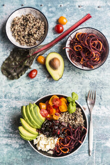 Lunch bowl of quinoa tricolore, chard, avocado, carrot spaghetti, tomatoes and feta - SARF03286
