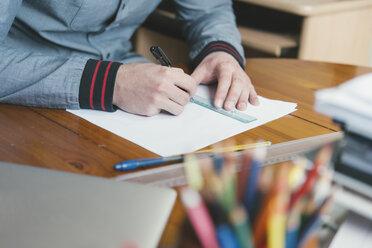 Close-up of man drafting at desk - SKCF00283