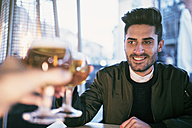 Young man drinking beer in a bar - JASF01719