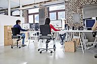 Group of people working in creative office - RHF01852