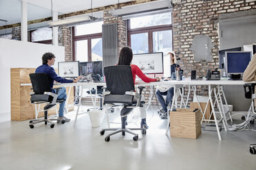 Group of people working in creative office - RHF01852