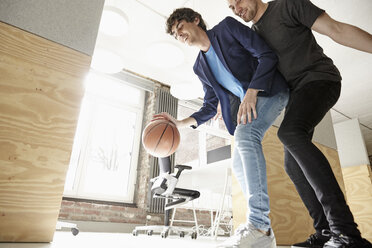 Young men in office playing basketball - RHF01909
