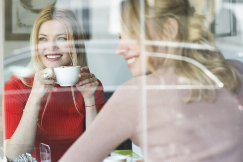 Two smiling young women in a cafe - FMOF00211