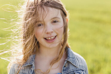 Portrait of smiling girl with blowing hair - NMSF00050
