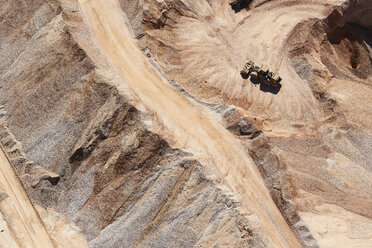 USA, Texas, aerial view of sand mine near San Antonio with a grader moving sand - BCDF00270