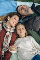 Happy family lying on blanket with closed eyes - DAPF00700