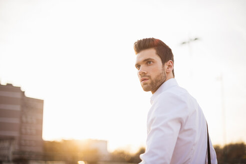 Portrait of young businessman  at sunset - DIGF02007