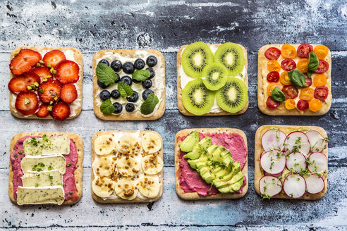 Two rows of various garnished sandwiches - SARF03303