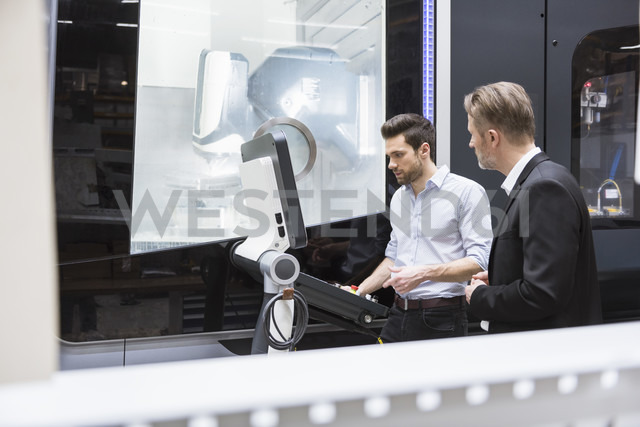 Two men at control in modern factory - DIGF02027
