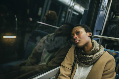 Portrait of young woman in underground train - KIJF01406