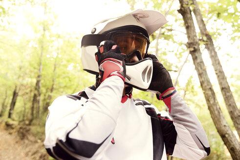 Italy, Motocross biker rinding in Tuscan forest - FMOF00234