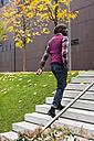 Man walking upstairs - MAUF01066
