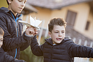 Portrait of boy with paper plane - ZOCF00220