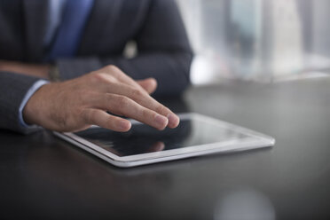 Businessman using tablet on table - ZEF13589