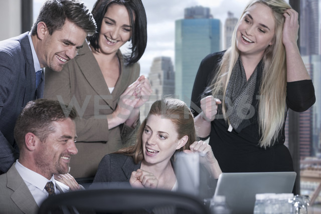 Group of happy with laptop in boardroom - ZEF13607