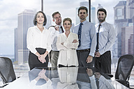 Portrait of confident businessmen and businesswomen in conference room - ZEF13616