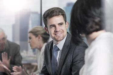 Smiling businessman in boardroom meeting - ZEF13646