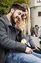 Young woman fedding her boyfriend with peel of an apple - MIDF00824