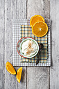 Bowl of orange curd creme with popped quinoa - MYF01910