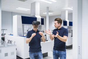 Two men in testing instrument room with VR glasses - DIGF02152