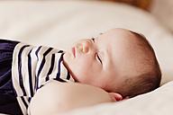 Portrait of baby girl sleeping on bed - NMSF00066