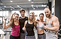 Fit friends having fun in gym - HAPF01568