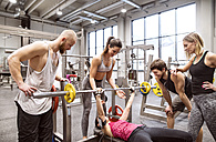 Group of people in gym training weight lifting - HAPF01589