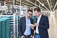 Two men with tablet talking in factory shop floor - DIGF02259