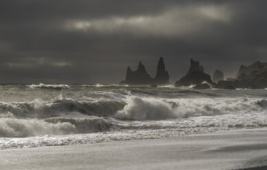 Iceland, Stone trolls and beach of black sand in Vik. - RAEF01869