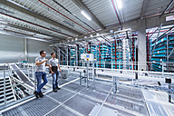 Two men in automatized high rack warehouse - DIGF02336