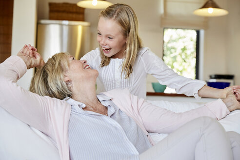 Little girl having fun with her grandmother at home - SRYF00306