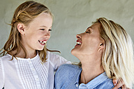 Laughing little girl face to face with her mother - SRYF00321