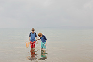 Two boys with dip net in the sea - NMSF00073