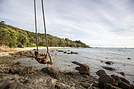 Thailand, Surat Thani, Ko Pha Ngan, woman on swing at Secret Beach - DAWF00531