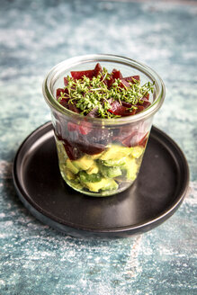 Glass of avocado betroot salad with snow peas and cress - SARF03314