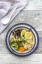 Bowl of ramen soup with spinach, carrot, boiled egg, bamboo sprouts and mushrooms - SARF03318