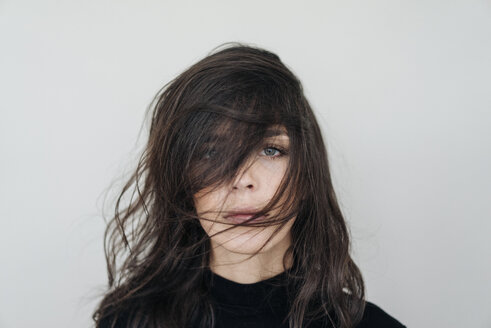 Portrait of dark-haired young woman with dishevelled hair - KNSF01242