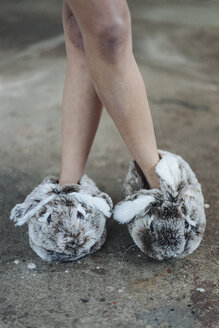Woman wearing cute fluffy slippers - KNSF01248