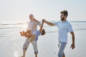 Happy grandfather, father and son on the beach - RORF00785