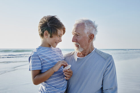 Grandfather with grandson on the beach - RORF00797